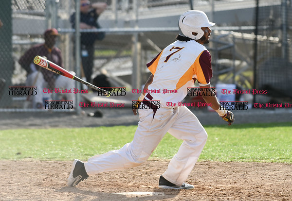 041017 Wesley Bunnell | Staff New Britain High School baseball defeated Bristol Central on Monday afternoon in a game played at Beehive Field. Josh Garcia (7) lets the bat fly after making contact.