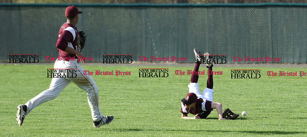 041017 Wesley Bunnell | Staff New Britain High School baseball defeated Bristol Central on Monday afternoon in a game played at Beehive Field. Mike Lemke (13) dives but is unable to come up with a shallow hit ball to right field.