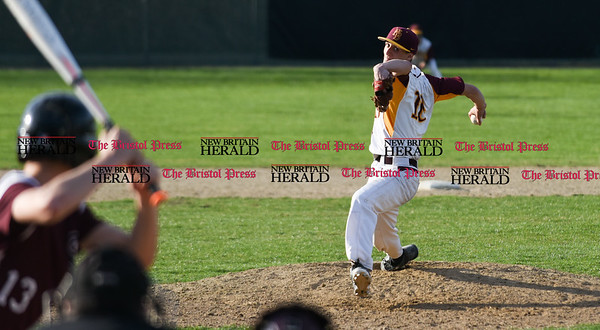 041017 Wesley Bunnell | Staff New Britain High School baseball defeated Bristol Central on Monday afternoon in a game played at Beehive Field. Will Homar (10) in mid delivery in the 7th inning.