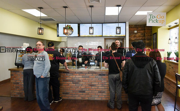 041017 Wesley Bunnell | Staff Mofongo Restaurant opened its doors to a packed crowd on Monday April 10. Customers que up to place their orders.