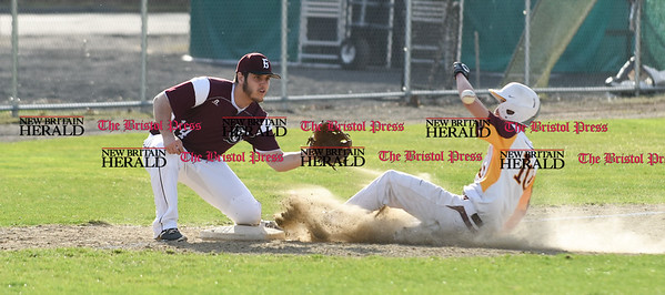 041017 Wesley Bunnell | Staff New Britain High School baseball defeated Bristol Central on Monday afternoon in a game played at Beehive Field. Will Homar (10) slides into third.