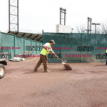 041017  Wesley Bunnell | Staff  Stadium preparation continues at the home of the New Britain Bees on Monday April 10.  Frank Fiordellesi, left, and John Wilczynski rake material into he warn ...