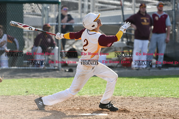 041017 Wesley Bunnell | Staff New Britain High School baseball defeated Bristol Central on Monday afternoon in a game played at Beehive Field. Justin Adorno (2) hits a fly ball to right field which would drop for a base hit despite great effort from the Bristol Central right fielder.