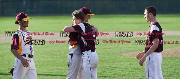 041017 Wesley Bunnell | Staff New Britain High School baseball defeated Bristol Central on Monday afternoon in a game played at Beehive Field. Will Homar (10), left, and Noah Plantamuro (5) shake hands and hug after the game.