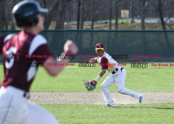 041017 Wesley Bunnell | Staff New Britain High School baseball defeated Bristol Central on Monday afternoon in a game played at Beehive Field. Danniel Rivera (1) fields and fires to 1st for the out.