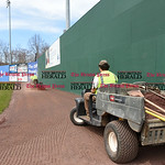 041017  Wesley Bunnell | Staff  Stadium preparation continues at the home of the New Britain Bees on Monday April 10.  Frank Fiordellisi drives down the warning track in right field filling  ...