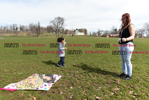 041017 Wesley Bunnell | Staff Central Park was packed with visitors enjoying a warm spring day on Monday April 10. Ashley Amador helps her 3 year old daughter, Emma-Sophia Domenech with her kite.