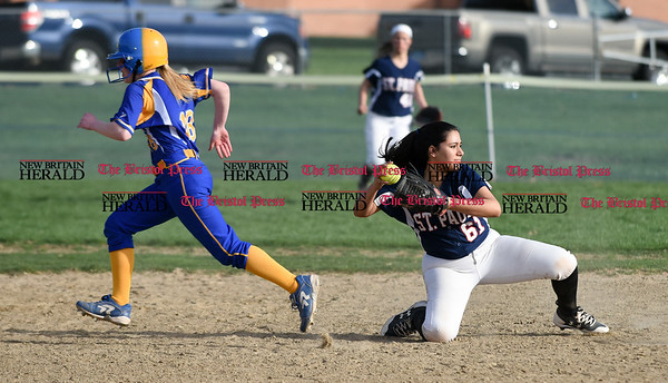 041717 Wesley Bunnell | Staff St. Paul softball was defeated by Seymour on Monday afternoon. Brooke Perez (61) fields but misses the tag on the Seymour runner.