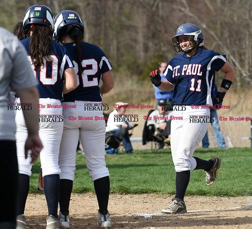 041717 Wesley Bunnell | Staff St. Paul softball was defeated by Seymour on Monday afternoon. Alessandra Milardo (11) is greeted by teammates after hitting a solo home run.