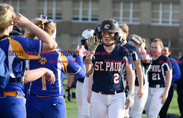 041717 Wesley Bunnell | Staff St. Paul softball was defeated by Seymour on Monday afternoon. Brigid Johndrow (2) prepares to shake hands with Seymour players after the loss.