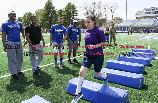 041717 Wesley Bunnell | Staff Students from Northend Elementary, Chamberlain Elementary, Smith Elementary and DiLoreto Magnet School's met at CCSU on Monday April 17 for inspiration to &quote;Finish the Race&quote; and pursue a college education in an event partnered by CCSU and the Ana Grace Project. Students ran obstacle courses run by the CCSU Football team.