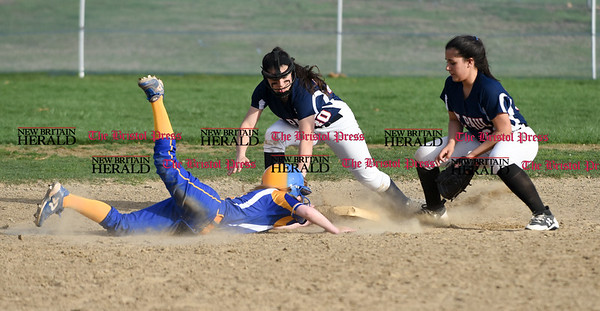 041717 Wesley Bunnell | Staff St. Paul softball was defeated by Seymour on Monday afternoon. Jess Persechino (30) tries to double off the Seymour runner but was not in time. Brooke Perez (61) on the right.