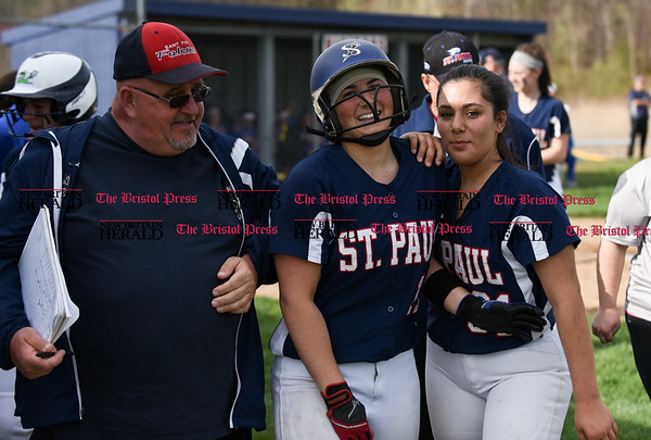 041717 Wesley Bunnell | Staff St. Paul softball was defeated by Seymour on Monday afternoon. Alessandra Milardo (11) smiles after hitting a solo home run and being congratulated by teammates.