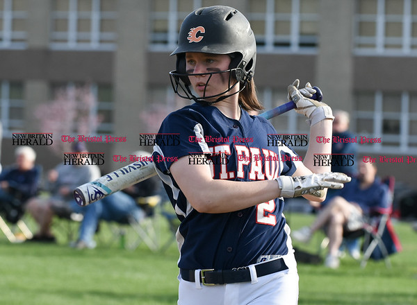 041717 Wesley Bunnell | Staff St. Paul softball was defeated by Seymour on Monday afternoon. Brigid Johndrow (2) takes a warmup swing before her at bat in the 7th inning.