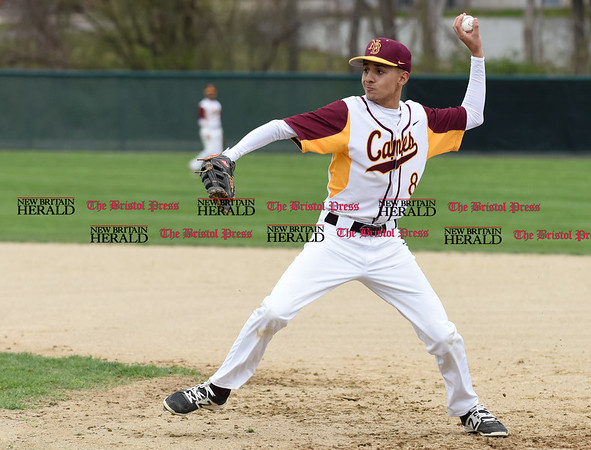 041917 Wesley Bunnell | Staff New Britain High School baseball defeated Southington 7-5 on Wednesday afternoon. Guillermo Burgos (8) makes the play at first and prepares to throw home but was unable to catch the Soutington runner.