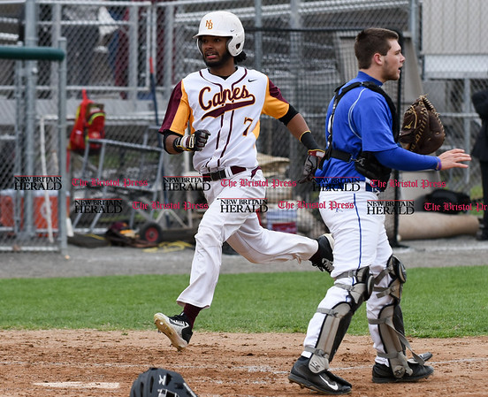 041917 Wesley Bunnell | Staff New Britain High School baseball defeated Southington 7-5 on Wednesday afternoon. Josh Garcia (7) comes home to score.