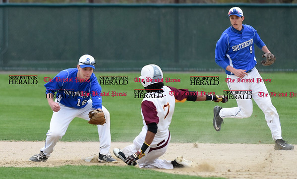 041917 Wesley Bunnell | Staff New Britain High School baseball defeated Southington 7-5 on Wednesday afternoon. Kyle Leifert (16) tags Josh Garcia (7) at second base for the out.