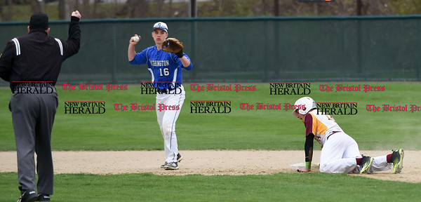 041917 Wesley Bunnell | Staff New Britain High School baseball defeated Southington 7-5 on Wednesday afternoon. Kyle Leifert (16) with the force out on Alex Silva (13).