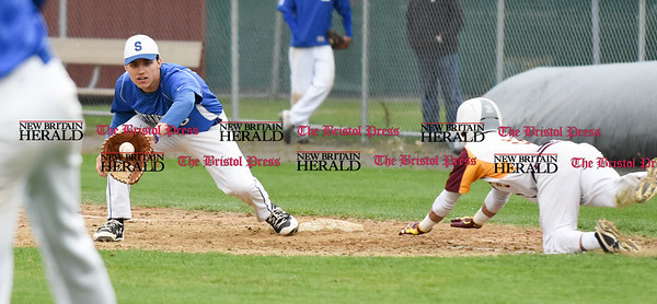 041917 Wesley Bunnell | Staff New Britain High School baseball defeated Southington 7-5 on Wednesday afternoon. Jeremy Mercier (10) receives the throw to force Taj McCall (5) on a bunt which was successful in advancing the runner to second base.