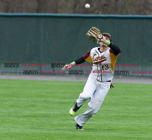 041917 Wesley Bunnell | Staff New Britain High School baseball defeated Southington 7-5 on Wednesday afternoon. New Britain right fielder Alex Silva (13) with a catch.