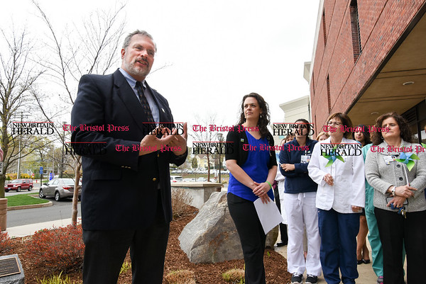 041917 Wesley Bunnell | Staff Life Choice and New England Donor Services held a flag raising ceremony at Bristol Hospital on Wednesday afternoonin honor of April as National Donate Life Month to encourage people to sign up as organ donors. Ken Smith from the hospitals pastoral services speaks.