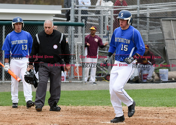 041917 Wesley Bunnell | Staff New Britain High School baseball defeated Southington 7-5 on Wednesday afternoon. Brayden Cooney (15) comes across to score.