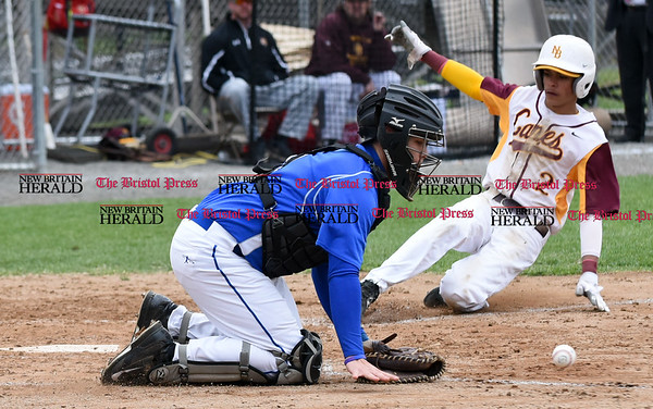 041917 Wesley Bunnell | Staff New Britain High School baseball defeated Southington 7-5 on Wednesday afternoon. Matthew Sciota (8) is unable to come up with a throw off line to tag New Britain's Justin Adorno (2).
