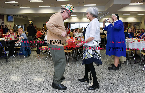 042017 Wesley Bunnell | Staff New Britain TRIAD held their 19th Annual Senior Prom with a Casino theme at New Britain High School on Thursday evening. Richard Aloisio dances with Mildred Shockley to Runaway.