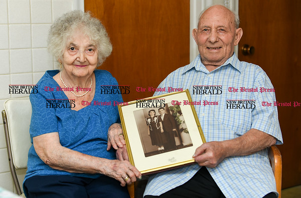 042017 Wesley Bunnell | Staff New Britain residents Catherine and Frank Teti recently celebrated their 70th wedding anniversary. The couple holds a photo taken in New Britain in the late 1940's.