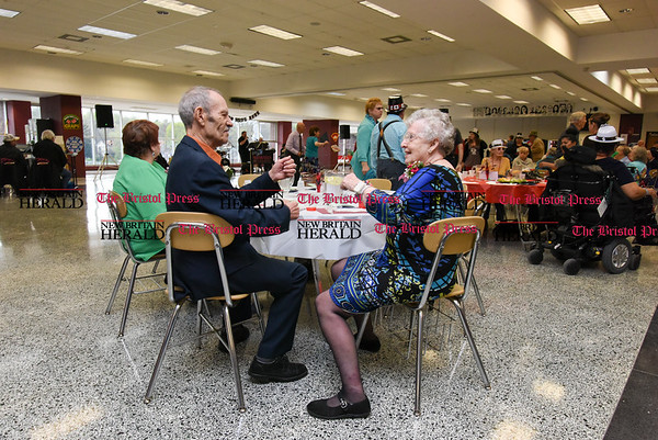 042017 Wesley Bunnell | Staff New Britain TRIAD held their 19th Annual Senior Prom with a Casino theme at New Britain High School on Thursday evening. Anthony Cintron and Martha Charpak start dancing at the table to City Cruise before hitting the dance floor.