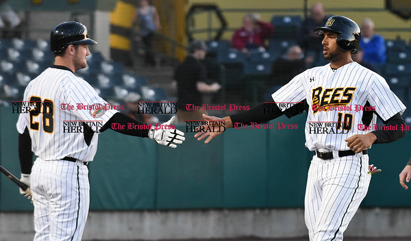041417 Wesley Bunnell | Staff New Britain Bees in their second exhibition game of the pre season on April 14 against the Greater Hartford Twilight League All Stars. Conor Bierfeldt (28) congratulates Mike Crouse (10) after scoring a run.