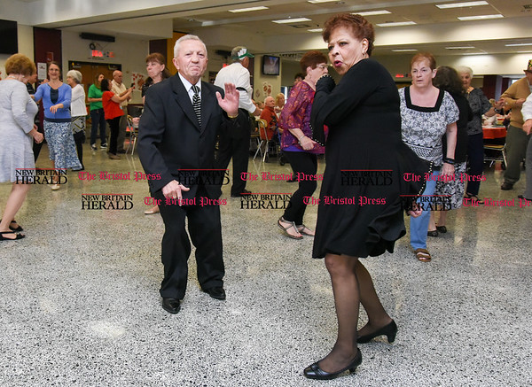 042017 Wesley Bunnell | Staff New Britain TRIAD held their 19th Annual Senior Prom with a Casino theme at New Britain High School on Thursday evening. Steve Gora and Juliana Meglio dance to music by the band The Sharades.