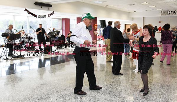 042017 Wesley Bunnell | Staff New Britain TRIAD held their 19th Annual Senior Prom with a Casino theme at New Britain High School on Thursday evening. Norman Raymond dressed as a card dealer dances with Carol Walenski to music from the band The Sharades.