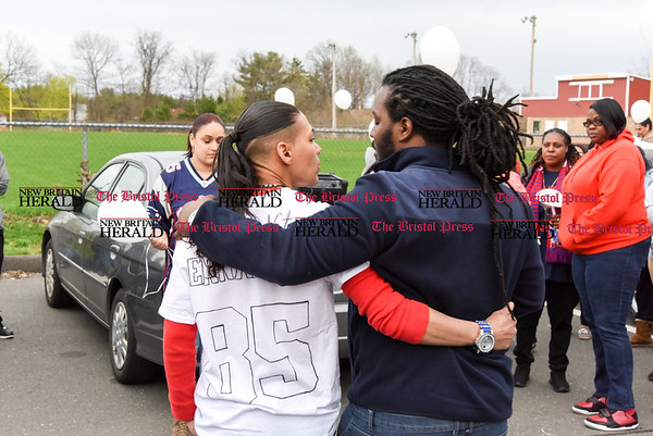 042417 Wesley Bunnell | Staff A candlelight vigil was held at Casey Field in Bristol by family and friends of former New England Patriot Aaron Hernandez. Sarah Hernandez gets a hug of support from a family friend before addressing the crowd.