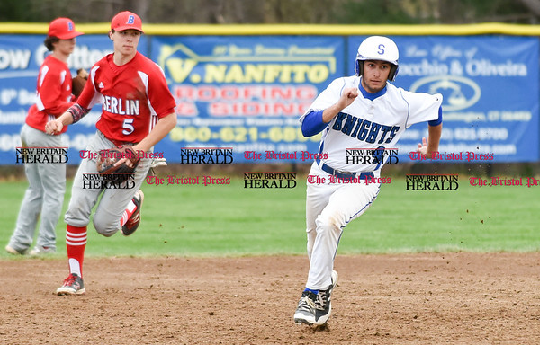 042417 Wesley Bunnell | Staff Southington High School baseball defeated Berlin on Monday afternoon in a game played at Southington. Southington's Kyle Semmel (4) rounds second base.