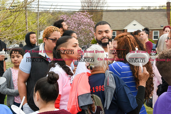 042417 Wesley Bunnell | Staff A candlelight vigil was held at Casey Field in Bristol by family and friends of former New England Patriot Aaron Hernandez. Many members of the crowd became emotional and broke down during the ceremony.