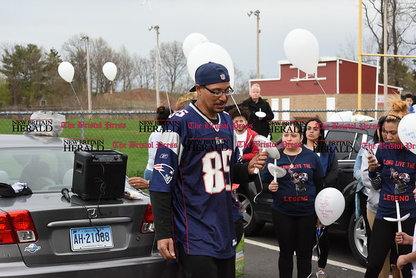 042417 Wesley Bunnell | Staff A candlelight vigil was held at Casey Field in Bristol by family and friends of former New England Patriot Aaron Hernandez. Family friend Everett Garcia breaks down with emotion while describing the impact Aaron had on his life.