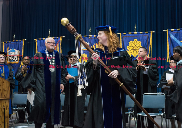 051916 Wesley Bunnell | Staff CCSU held their 2016 Graduate School Commencement Exercises on Thursday evening in Kaiser Hall. Faculty exits the stage as pomp and circumstance plays.