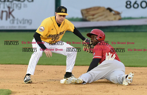 042717 Wesley Bunnell | Staff The New Britain Bees vs the Lancaster Barnstormers played on Thursday evening. Jake McGuiggan (2) fields the throw from James Skelton (3) on a steal with the Lancaster runner safe on the play.