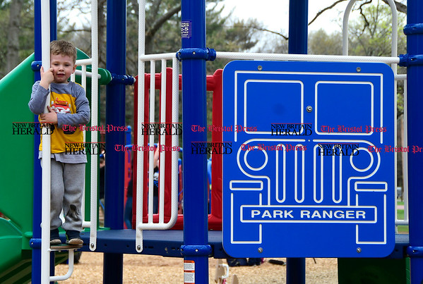 4/27/2017 Mike Orazzi | Staff William Nolan,4,while enjoying the recently renovated playground in Plainville's Norton Park Thursday.