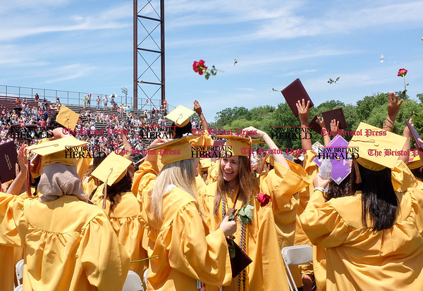 061616 Wesley Bunnell | Staff New Britain High School's Graduation Exercises took place on Thursday at 11:00am at Veteran's Memorial Stadium Willow Brook Park. Graduates toss their roses into the air at the end of the ceremony.