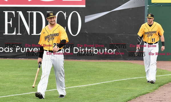042717 Wesley Bunnell | Staff The New Britain Bees vs the Lancaster Barnstormers played on Thursday evening. Conor Bierfeldt (28) walks onto the field after hitting in the batting cage before the start of the game along with Paul Kronenfeld (11).