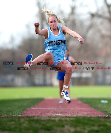 4/11/2017 Mike Orazzi | Staff Middletown's Cassie More in the long jump at Bristol Eastern.