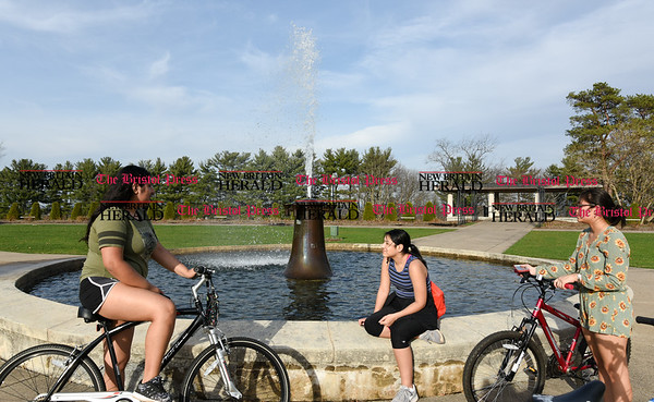 041117 Wesley Bunnell | Staff Luciana Munoz, left, Donna Munoz and Ashley Beslanga stopped for a break by the fountain in the Rose Garden area of Walnut Hill Park on Tuesday afternoon.