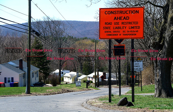4/11/2017 Mike Orazzi | Staff Construction signs off West Street at the intersection with West Center Street in Southington.