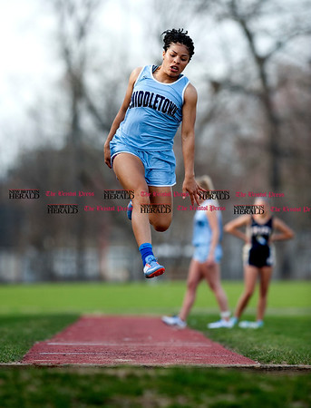 4/11/2017 Mike Orazzi | Staff Middletown's Jennifer Barber in the long jump at Bristol Eastern.