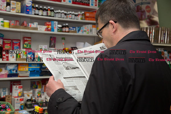 Poland's ambassador to the U.S. Piotr Wilczek takes a look at a Polish newspaper at Max-Mart on Broad Street in New Britain, April 1, 2017. (Photo by Christopher Zajac)