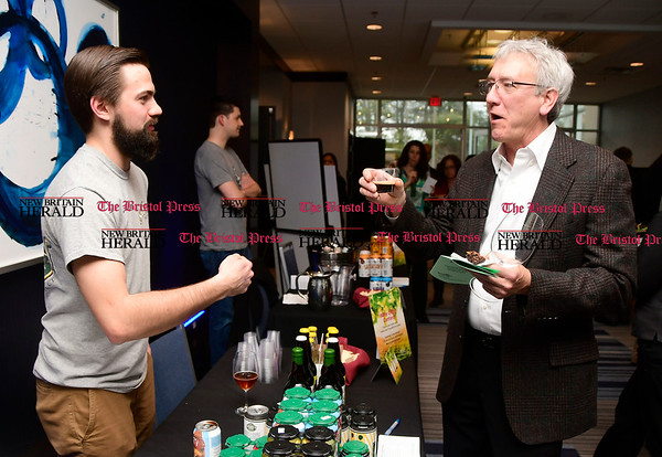 4/1/2017 Mike Orazzi | Staff Shebeen Brewing Company Derek Ives serves a beer sample to Jeff Hahn during the Bristol Hospital Development Foundation's Festival of Wines & Spirits held at the DoubleTree by Hilton in Bristol Saturday night. The money raised this year will go toward a future renovation project at the hospitals Emergency Center.