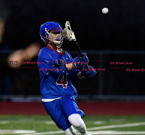 4/1/2017 Mike Orazzi | Staff St. Paul Catholic High School's Charlie Panke (4) during lacrosse with Bristol Central Saturday night.