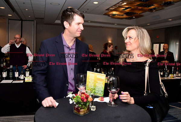 4/1/2017 Mike Orazzi | Staff Michael Fries and Jennifer Lowell during the Bristol Hospital Development Foundation's Festival of Wines & Spirits held at the DoubleTree by Hilton in Bristol Saturday night. The money raised this year will go toward a future renovation project at the hospitals Emergency Center.